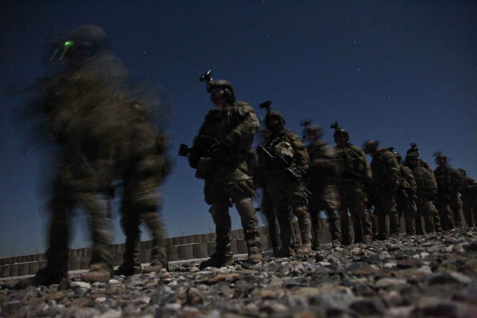 soldiers marching at night