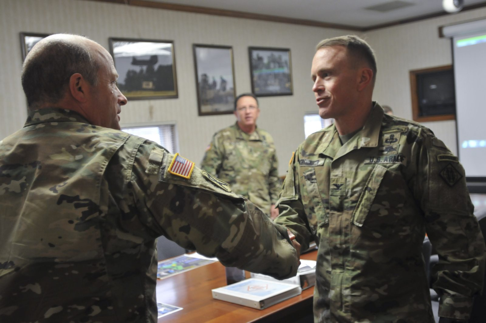 soliders shaking hands in office