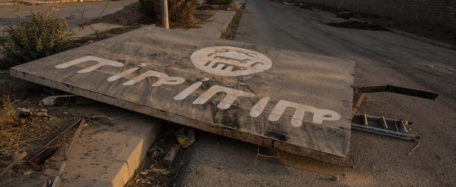 fallen billboard in Iraq