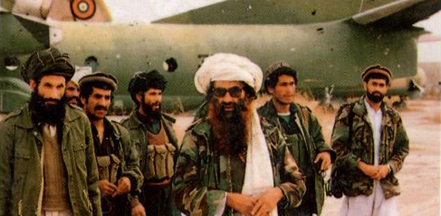 Haqqani Network – men in camouflage jackets in front of airplane